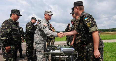 Does U.S. military presence in Ukraine violate the Minsk-2 peace deal?