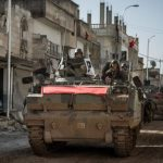 Turkey and ISIS attack Kurdish forces in two regions of northern Syria