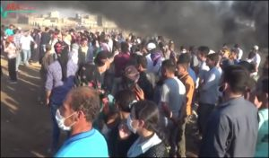 Kurdish people of Kobane, Syria protest on Sept 3, 2016 against Turkey building a separation wall along Syria-Turkey border