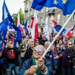 In Poland, anti-gov't, pro-democracy rally draws tens of thousands