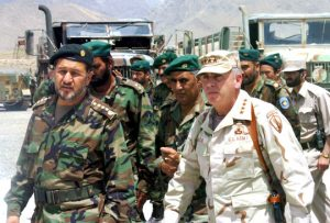 Retired U.S. General John Philip Abizaid, former commander of U.S. Central Command, pictured here (R) in Iraq in 2005