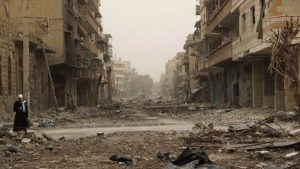 Shattered eastern Syria city of Deir al-Zour pictured in Feb 2013 (Reuters)