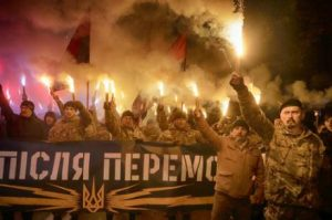 Far-right 'Azov Battalion' cadre hold rally in Kyiv on Oct 14, 2016. Banner reads 'Peace after victory' (Efrem Lukatsky, AP)