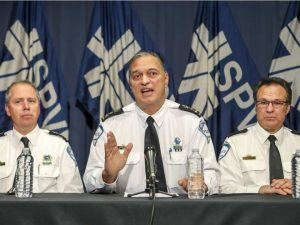 Montreal Police Chief Philippe Pichet flanked by subordinates at press conference on Oct 31, 2016 (John Mahoney, Montreal Gazette)
