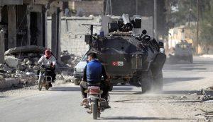Turkish armoured vehicle in Al-Rai, Aleppo province of Syria (Khalil Ashawi, Reuters)