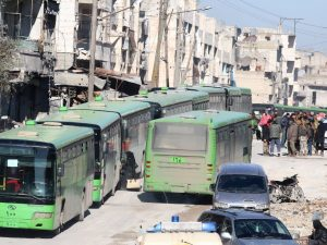 Buses provided by Syrian government conduct evacuations from eastern Aleppo (Ismail Abdalrhman, Reuters)