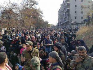 People gather to leave Al-Salhen neighborhood in eastern Aleppo on Dec 8, 2016 (European Pressphoto Agency-EPA)