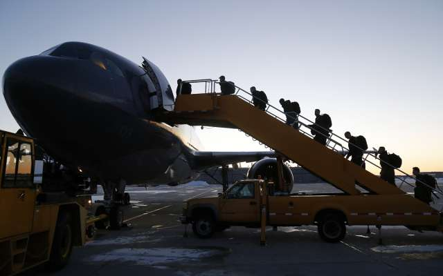 About 125 members of the 3rd Battalion, the Royal Canadian Regiment board a C-150 Airbus at 8 Wing/CFB Trenton, Ont. as they deploy on Operation Reassurance in Eastern Europe on March 2, 2015.