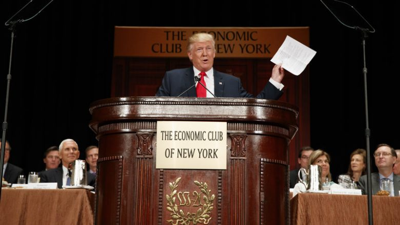 Donald Trump holds up notes as he speaks to the Economic Club of New York. Evan Vucci/AP