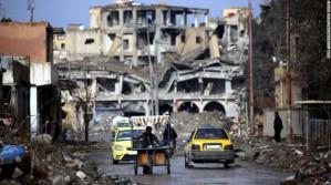 Amnesty International says US-led strikes on Raqqa may amount to war crimes