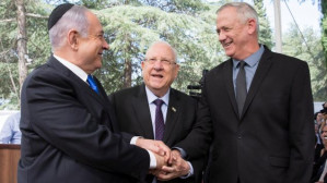 As Israel's Netanyahu uses coronavirus to consolidate power, his chief rival caves in